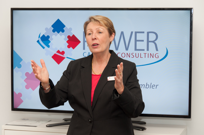 Photo of Jo Shambler presenting in front of television